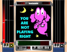 In game image of beatmania complete MIX on the Arcade.