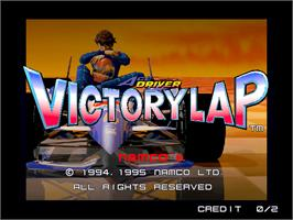 Title screen of Ace Driver: Victory Lap on the Arcade.