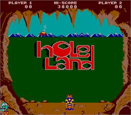 Title screen of Hole Land on the Arcade.
