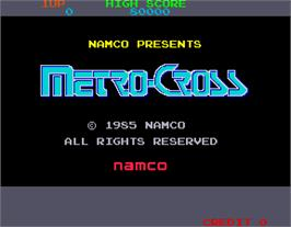 Title screen of Metro-Cross on the Arcade.