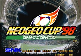 Title screen of Neo-Geo Cup '98 - The Road to the Victory on the Arcade.