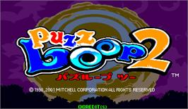 Title screen of Puzz Loop 2 on the Arcade.