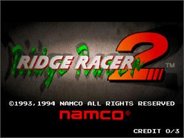 Title screen of Ridge Racer 2 on the Arcade.