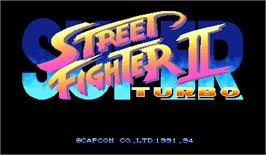 Title screen of Super Street Fighter II Turbo on the Arcade.