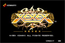 Title screen of Xexex on the Arcade.