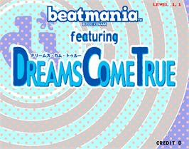 Title screen of beatmania featuring Dreams Come True on the Arcade.