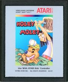 Cartridge artwork for Holey Moley on the Atari 2600.