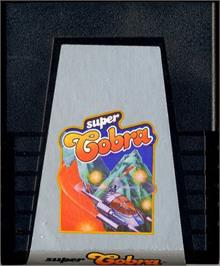 Cartridge artwork for Super Cobra on the Atari 2600.