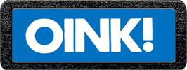 Top of cartridge artwork for Oink! on the Atari 2600.