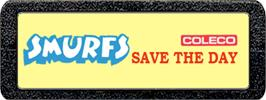 Top of cartridge artwork for Smurfs Save the Day on the Atari 2600.