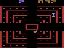 In game image of Dodge 'Em on the Atari 2600.