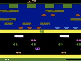 In game image of Frogger on the Atari 2600.