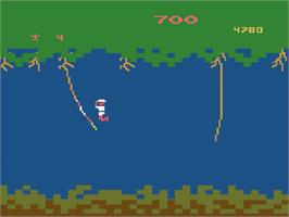 In game image of Jungle Hunt on the Atari 2600.
