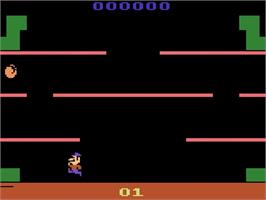 In game image of Mario Bros. on the Atari 2600.