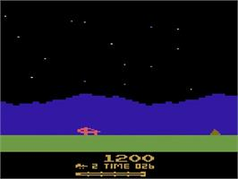 In game image of Moon Patrol on the Atari 2600.