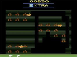 In game image of Mr. Do! on the Atari 2600.