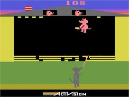 In game image of Oink! on the Atari 2600.