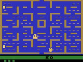 In game image of Pac-Man on the Atari 2600.