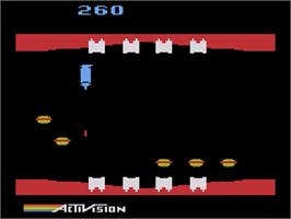 In game image of Plaque Attack on the Atari 2600.