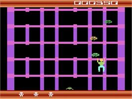 In game image of Squish 'Em on the Atari 2600.