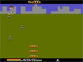 In game image of Kaboom on the Atari 5200.