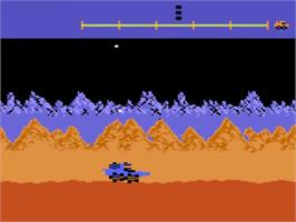 In game image of Moon Patrol on the Atari 5200.