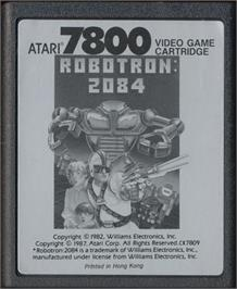 Cartridge artwork for Robotron on the Atari 7800.
