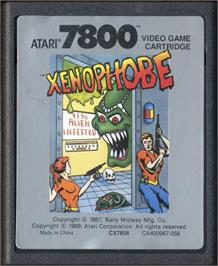 Cartridge artwork for Xenophobe on the Atari 7800.