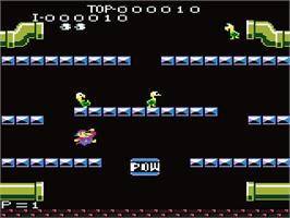 In game image of Mario Bros. on the Atari 7800.