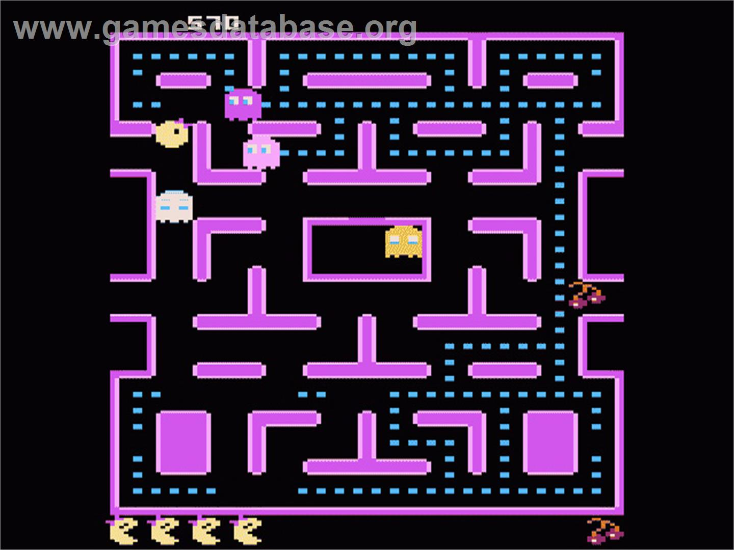 In game image of Ms. Pac-Man on the Atari 7800.