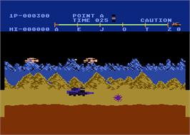 In game image of Moon Patrol on the Atari 8-bit.