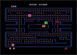 In game image of Pac-Man on the Atari 8-bit.