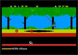 In game image of Pitfall on the Atari 8-bit.