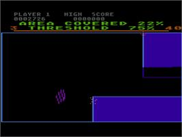 In game image of Qix on the Atari 8-bit.