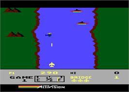 In game image of River Raid on the Atari 8-bit.