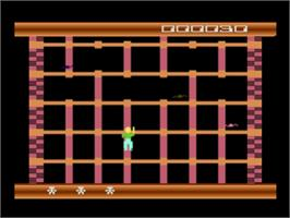 In game image of Squish 'em on the Atari 8-bit.