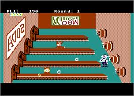 In game image of Tapper on the Atari 8-bit.