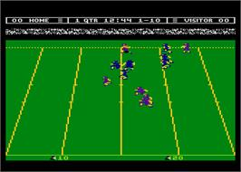 In game image of Touchdown Football on the Atari 8-bit.