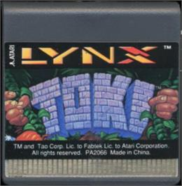 Cartridge artwork for Toki: Going Ape Spit on the Atari Lynx.