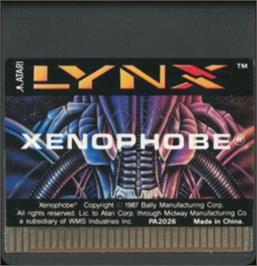 Cartridge artwork for Xenophobe on the Atari Lynx.