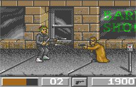 In game image of Dirty Larry: Renegade Cop on the Atari Lynx.