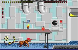 In game image of Gordo 106: The Mutated Lab Monkey on the Atari Lynx.