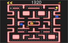 In game image of Ms. Pac-Man on the Atari Lynx.