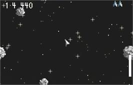 In game image of Super Asteroids and Missile Command on the Atari Lynx.