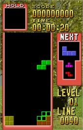 In game image of Tetris on the Bandai WonderSwan Color.