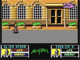 In game image of Alien Storm on the Commodore 64.