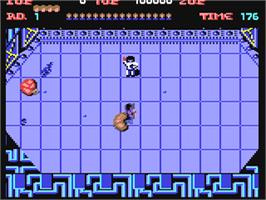 In game image of Alien Syndrome on the Commodore 64.
