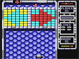 In game image of Arkanoid 2: Revenge of Doh on the Commodore 64.