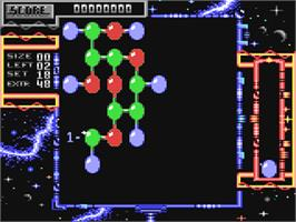 In game image of Atomino on the Commodore 64.