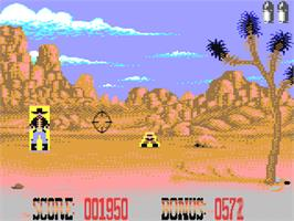 In game image of Buffalo Bill's Wild West Show on the Commodore 64.